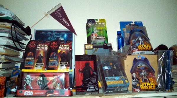 My STAR WARS action figures and other collectibles inside my closet at home.
