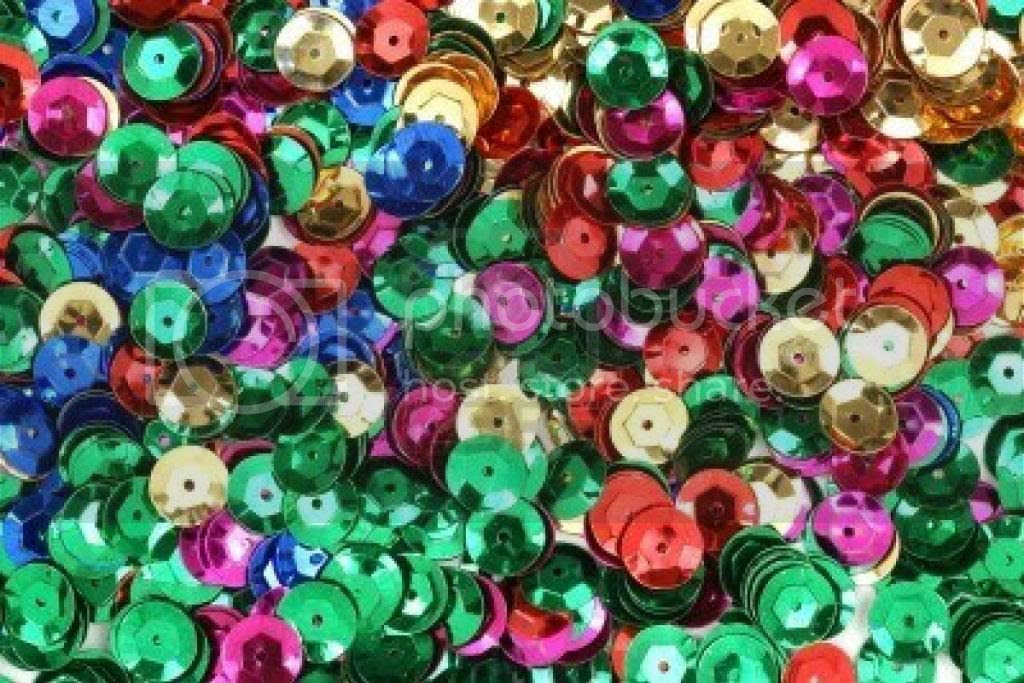 photo 5999875-close-view-of-server-al-different-colored-sequins-used-for-arts-and-crafts_zps48305c98.jpg