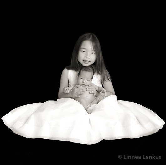 Linnea Lenkus Fine Art Portrait Studios — This older sister was great at holding her baby...