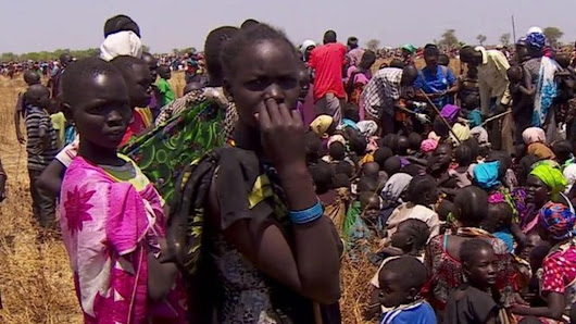 South Sudan: People queue for food cards and vaccination - BBC News