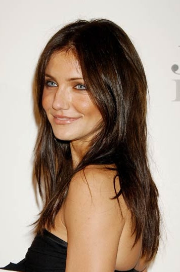 Hair: Dark brown with natural redish and light brown highlights