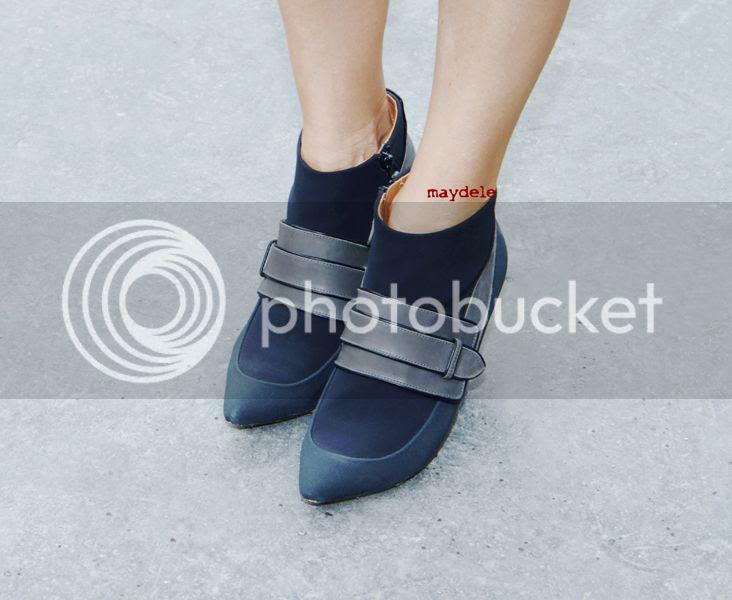 Alexandra Golovanoff wearing Balenciaga neoprene belted ankle boots close-up