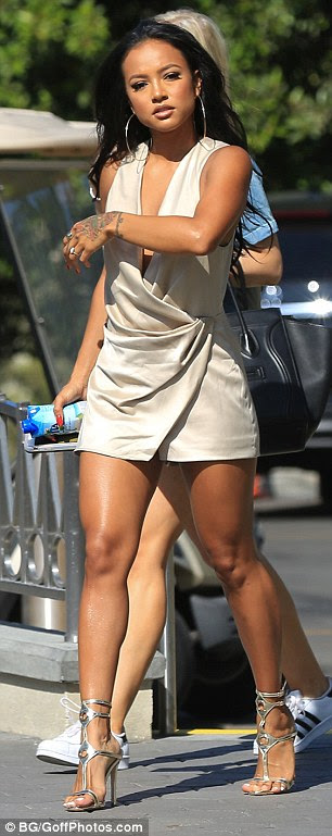 Taking the plunge: The aspiring actress, 28, left little to the imagination as she sizzled in a daring plunging nude playsuit for her afternoon on set