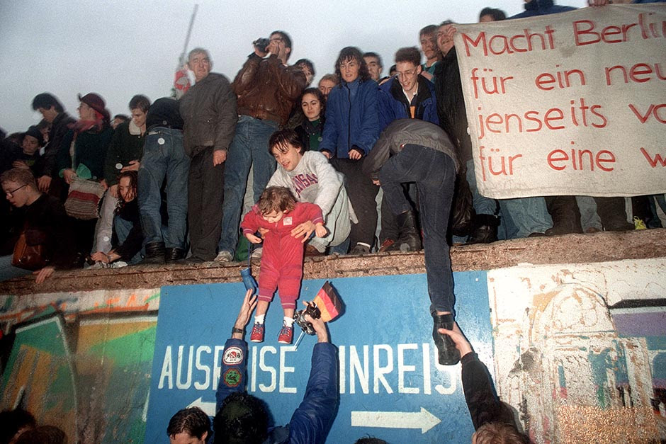 People from East Germany greet West German residents