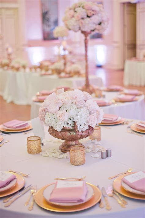 White, champagne and pale pink wedding flowers and decor