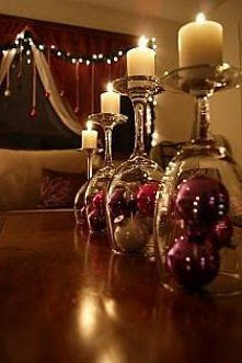 saw this idea using miniature santa claus with snow for background.  plan on doing this on my mantel this christmas. Great use of wine glasses