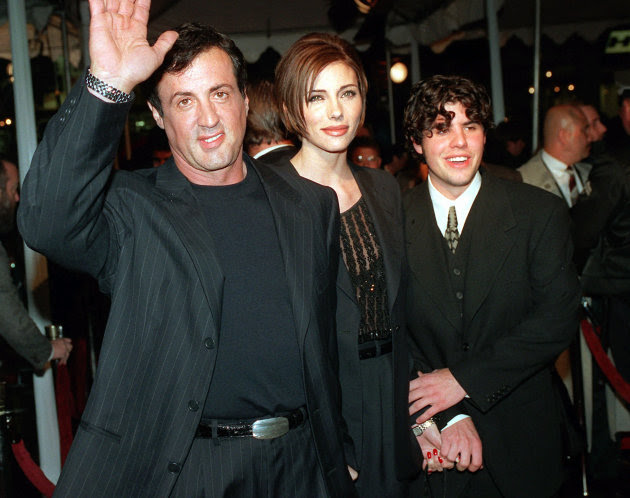 "FILE - In this Dec. 5, 1996 file photo, Sylvester Stallone, left, star of the film ""Daylight,"" arrives at the film's world premiere with his girlfriend Jennifer Flavin, center, and his son Sage Stallo"