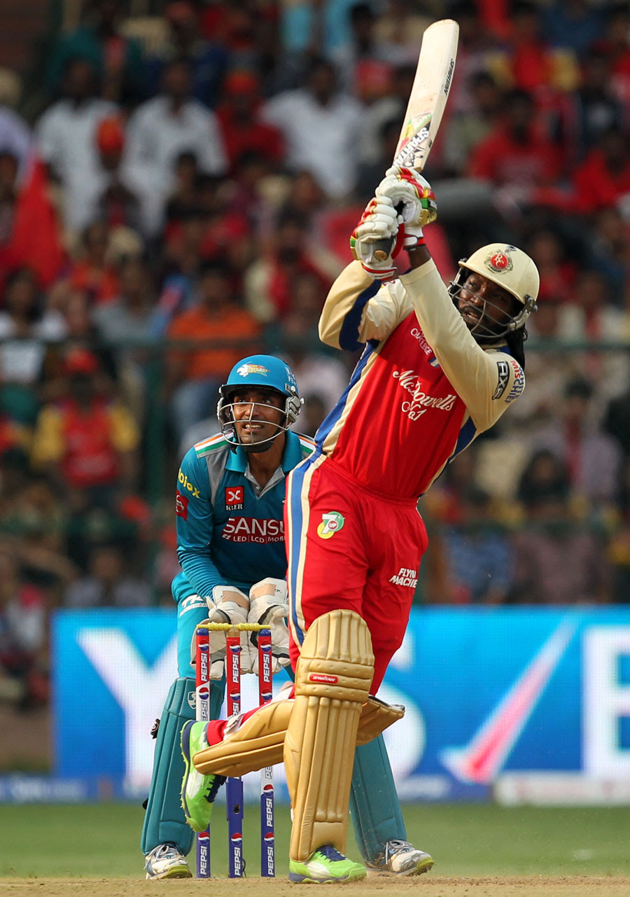 Chris Gayle celebrates his 30-ball hundred