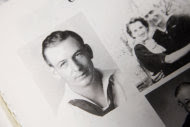 This Nov. 29, 2011, photo taken in in Greenfield, Iowa, shows a page of photos showing World War II Navy veteran Clarence Pfundheller taken in November of 1941. Now 91, Pfundheller will be returning to Pearl Harbor on Wednesday, Dec. 7, 2011, for the 70th anniversary ceremony honoring those lost in the Dec. 7, 1941 attack that brought the United States into World War II. Accompanying him will be fellow survivors, other World War II veterans, and a handful of college students to hear their stories. (AP Photo/Charlie Neibergall)