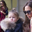 Runway ready! Harper Beckham steals the spotlight from Victoria in cute fur-trimmed coat as pair jet into New York for Fashion Week