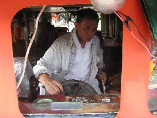 Lead actor Chung Kok Keong driving a boat