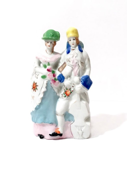 https://www.etsy.com/listing/632774893/victorian-couple-ceramic-planter-figural?ref=shop_home_active_1...