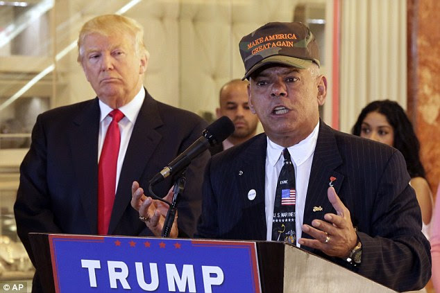 Al Baldasaro, a key Donald Trump veterans affairs adviser (pictured at a Donald Trump press conference on May 31) told a radio host that Hillary Clinton should be 'shot for treason'