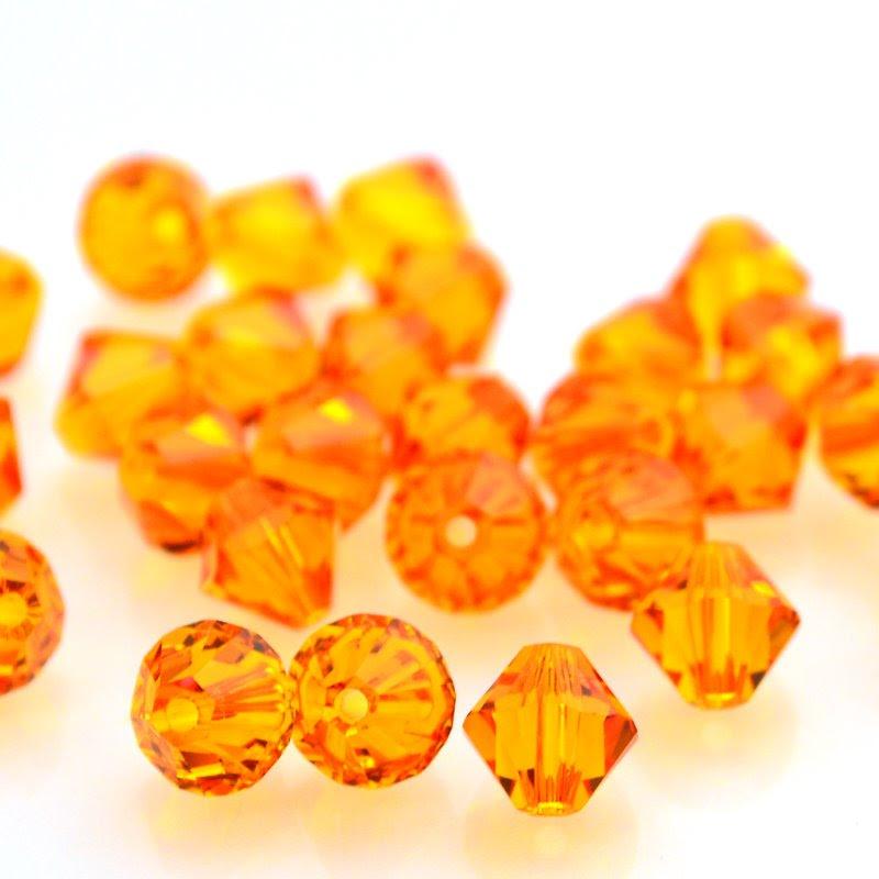 27753012015259 Swarovski Bead - 6 mm Faceted Xilion Bicone (5328) - Tangerine (1)