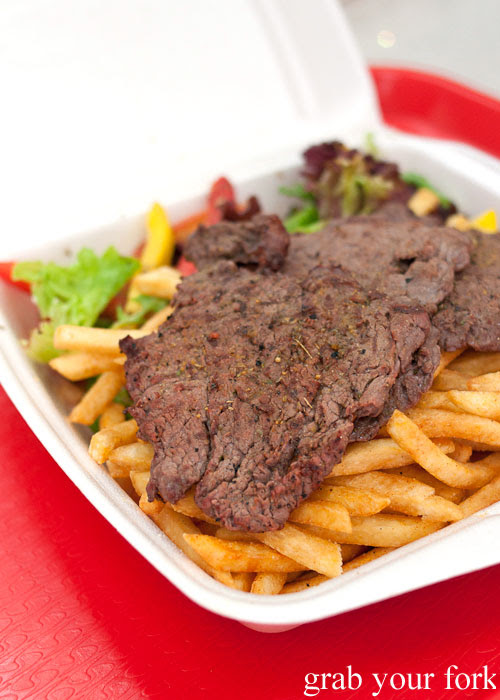 Camel tenderloin steak with chips and salad
