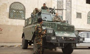Police troopers secure a street in Sanaa August 5, 2013.