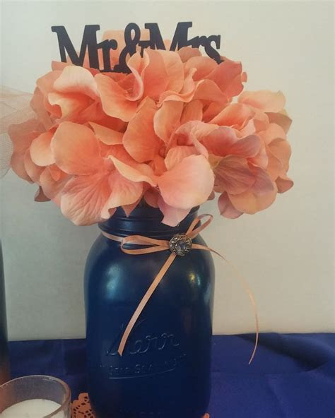 Navy blue mason jar and coral centerpiece by