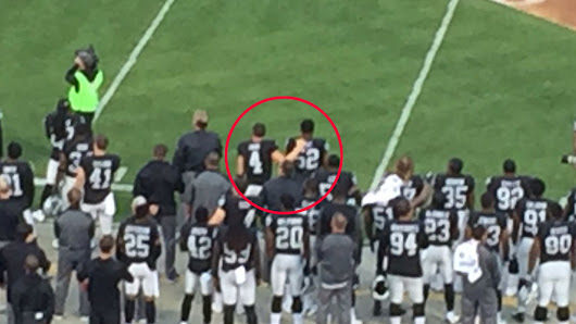 Derek Carr says he placed his hand on Khalil Mack during the national anthem to 'unify people'
