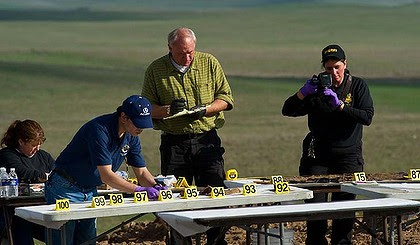 Huge find ...  police sort through the human remains recovered from a well on an abandoned cattle ranch.