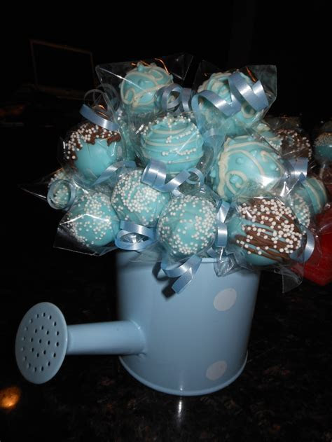 Baby boy cake pops in a watering can for a baby shower