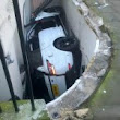2014 Range Rover Sport ends up in front of a basement after a serious crash