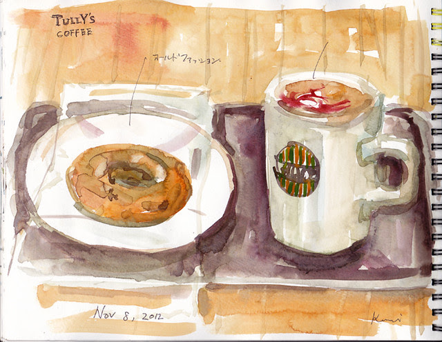 A doughnut and coffee with raspberry flavor