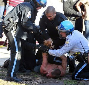 Washington D.C. cops arrest members of the Occupy DC encampment. The attacks follow a similar pattern in many cities throughout the United States. by Pan-African News Wire File Photos