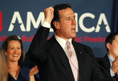 Republican U.S. presidential candidate and former U.S. Senator Rick Santorum speaks to supporters as his wife Karen (L) applauds at his Alabama and Mississippi primary election night rally in Lafayette, Louisiana, March 13, 2012. REUTERS/Jonathan Bachman