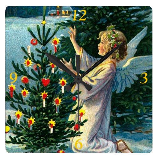 Angel Decorating Christmas Tree 2 Clocks from Zazzle.