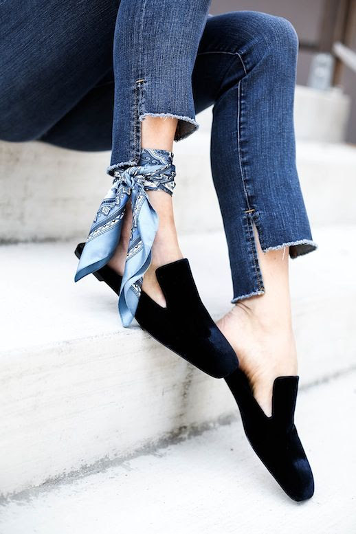 Le Fashion Blog Fall Style Asymmetric Hem Jeans Silk Scarf Tied Around Ankle Black Velvet Loafers Via Honestly WTF