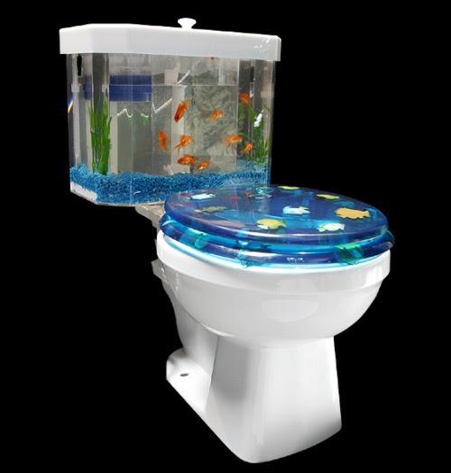 Trata-se de um vaso sanitário real.  O tanque claro está dividido em duas secções.  A frente é o tanque de peixes, a volta é uma área separada onde o tanque se esvazia quando você lave.  O link 'clique thru' leva você para mais fotos de como ele funciona ...