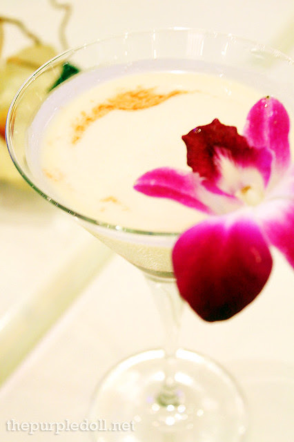 Noni Kiss (P295) - White Rum, Amaretto, Half Cream, Noni Syrup and Red Candy Shavings