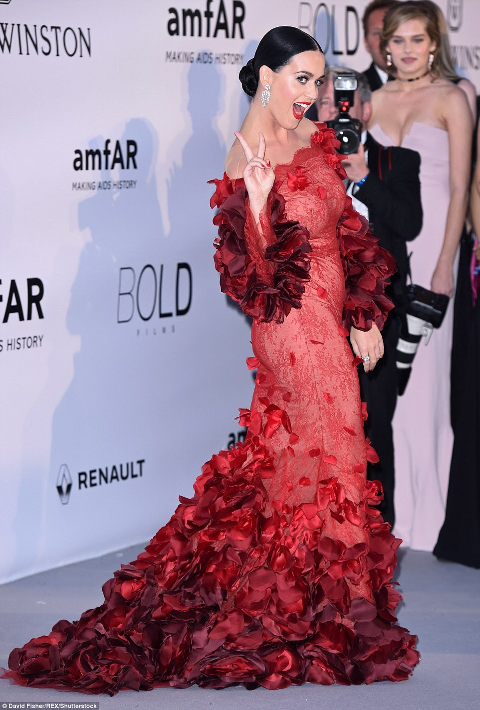 Peace of me: Katy flashed a peace sign on the red carpet as she headed into the star-studded event