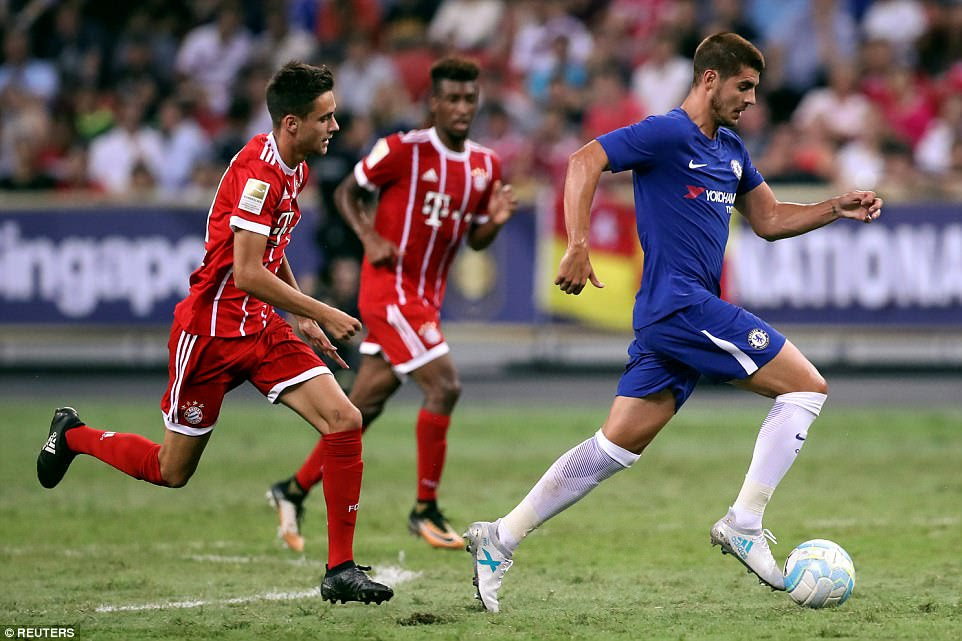 Morata, who arrived at Chelsea from Real Madrid in a £70million deal last week, runs with the ball during his debut