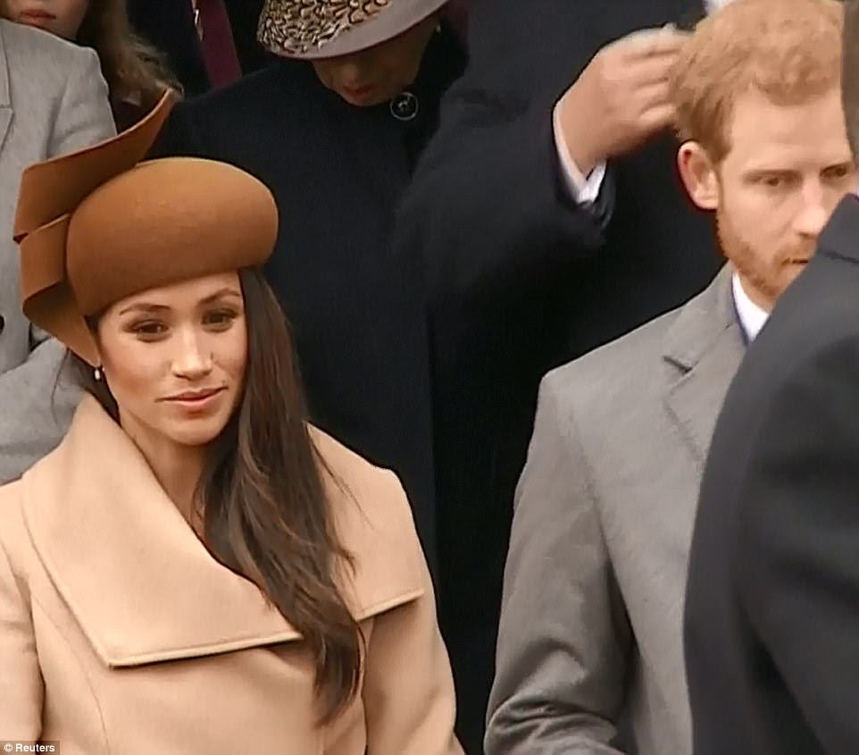 Deep breaths: Meghan's face sunk momentarily as she lined up next to her fiance to take her curtsy