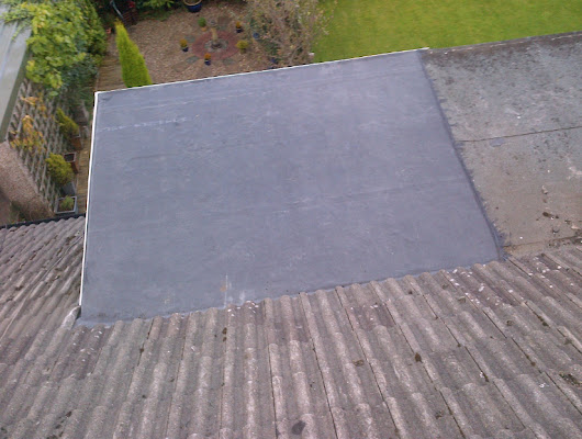 The Advantages of a Flat Roof Extension for Your Home - A Grand Rapids Roofing Company