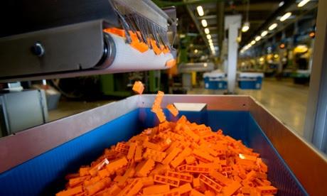 Toy blocks fall into bins at a Lego factory in Billund, Denmark