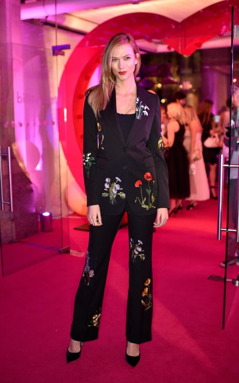 Karlie Kloss wore a floral Stella McCartney suit to London Fashion Week, which she then worked into her day wardrobe by wearing the trousers with white trainers