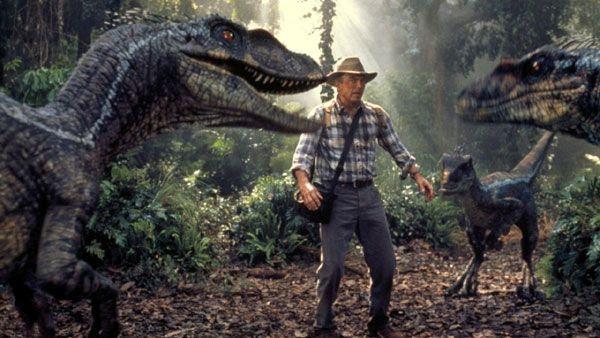 Dr. Alan Grant (Sam Neill) confronts a horde of Velociraptors in JURASSIC PARK III.