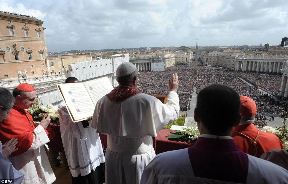 Delivery: Pope Francis delivers the Urbi et Orbi message and blessing to at least 250,000 faithful after the Easter Holy Mass at St Peter's Square