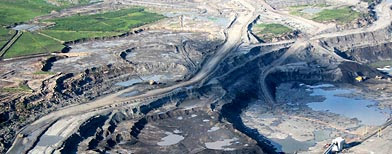 File photo of open pit mines just north of Fort McMurray in Alberta, Canada (AP/Canadian Press, Eamon Mac Mahon)