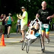 Rick van Beek runs In Triathlons carrying his daughter Maddy | WC News