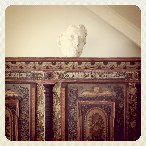 vintage armoire and sculpture