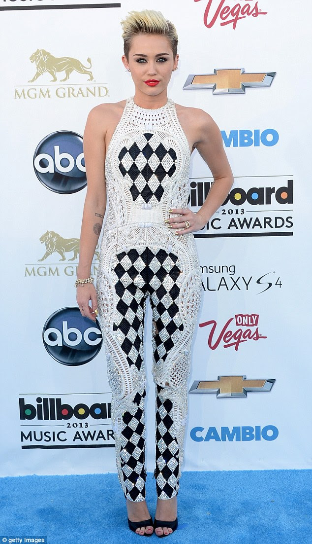 Doily disaster: Miley Cyrus slipped into a crochet jumpsuit as she made her arrival at the 2013 Billboard Music Awards on Sunday night at the MGM Grand Hotel in Las Vegas, Nevada