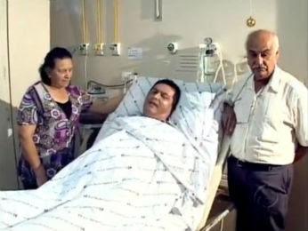 João Rodrigues ao lado dos pais, no quarto do Hospital Evangélico (Foto: Reprodução/ RPC TV)
