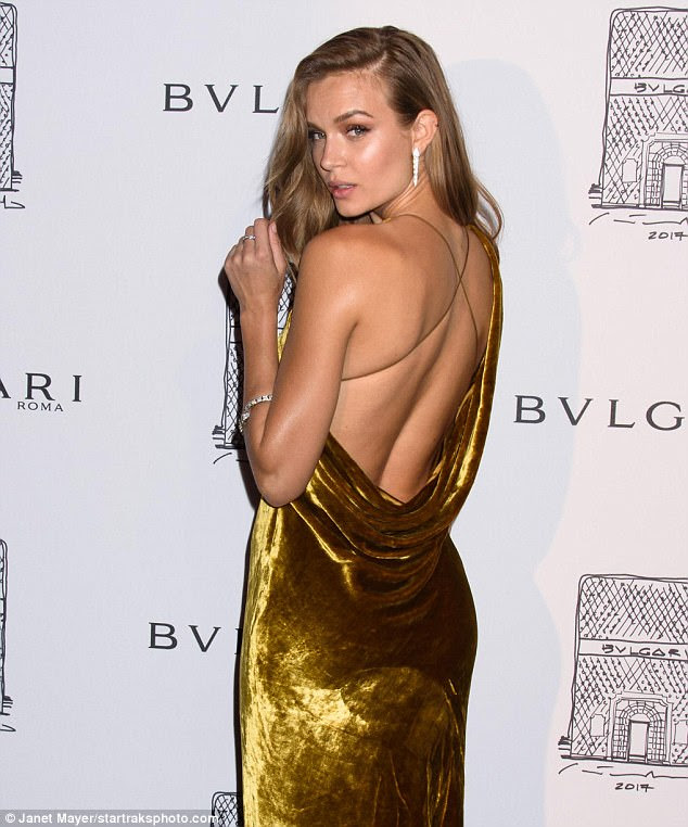 Sultry: The back of the frock featured a draped accent with a deep-thigh slit
