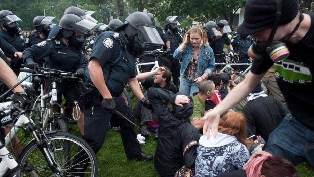 Police clear protesters at Queen's Park in 2010