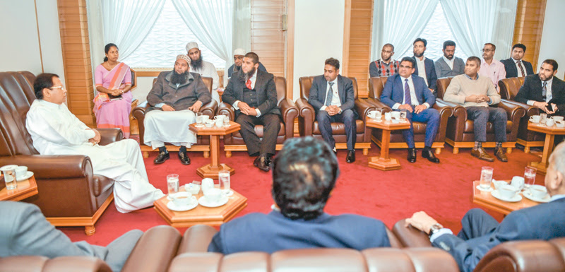 A group of representatives of the Sri Lankan Muslim community living in Japan called on President Maithripala Sirisena at the Imperial Hotel in Tokyo yesterday. Picture by Sudath Silva