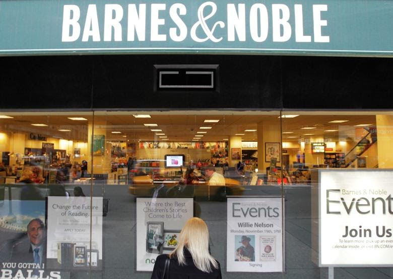 A woman looks in from a window panel of a Barnes & Noble store in New York October 24, 2012.  REUTERS/Brendan McDermid