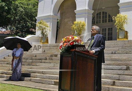 Sri Lanka's prime minister Ranil Wickremesinghe speaks as his wife Maithree watches during a media interaction at his official residence in Colombo, Sri Lanka, Wednesday, Aug. 19, 2015. Wickremesinghe defeated the country's former strongman Mahinda Rajapaksa in parliamentary elections, according to results released Tuesday, Aug. 18, 2015, blocking a key step of his bid to return to power eight months after he lost the presidency.